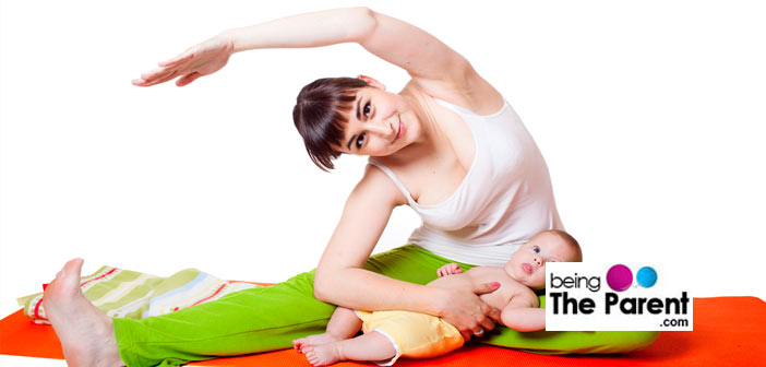 Mother exercising with baby