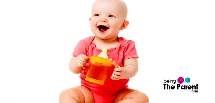 Baby having fruit juice