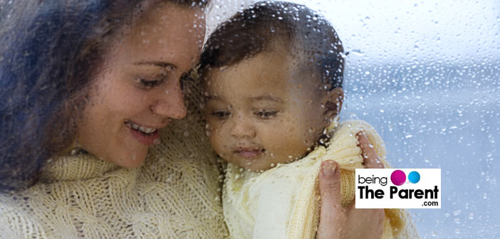 Mom and baby enjoy rain