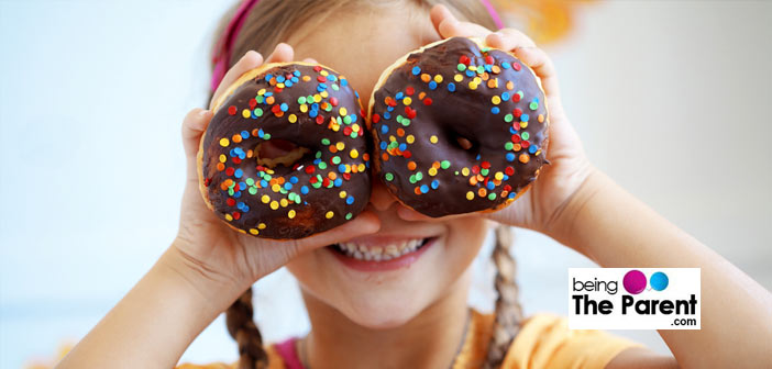 Child with doughnuts