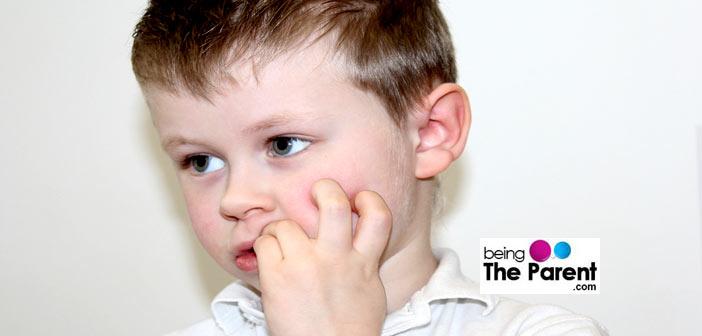 Boy biting his nails