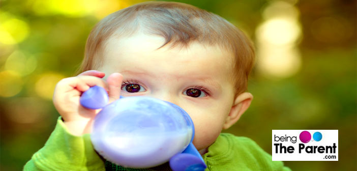 Baby drinking from sippy cup