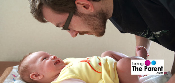 Dad changing baby