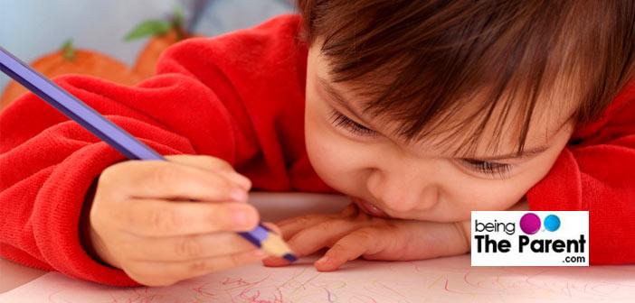 Little girl scribbling