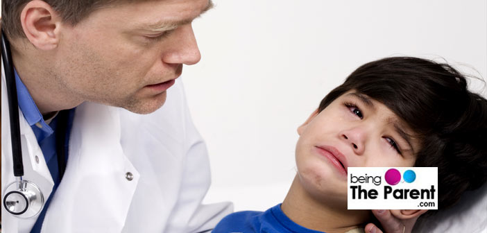 Unhapy child with doctor