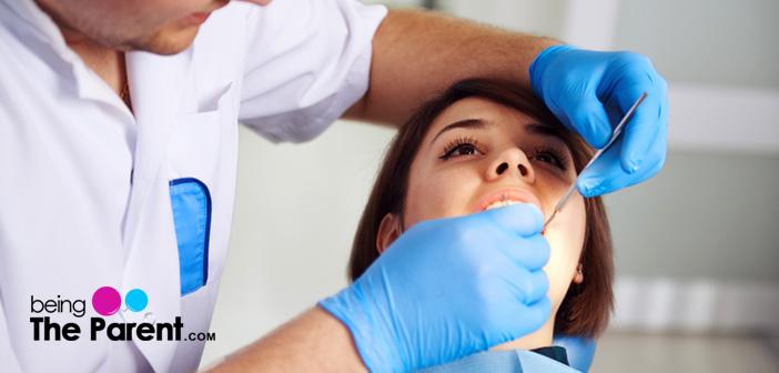 Woman taking dental treatment