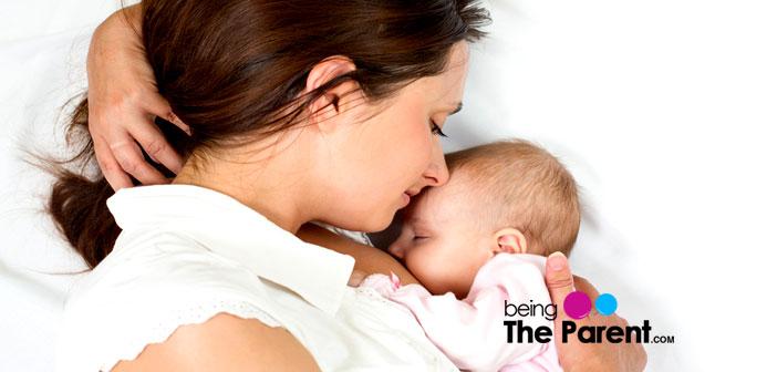 Woman breastfeeding baby