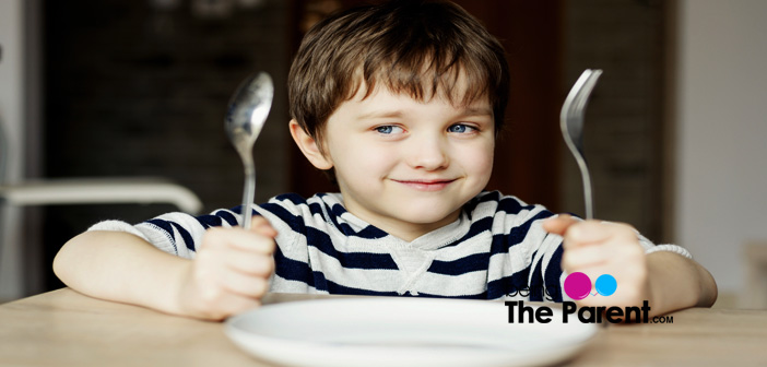Child using fork and knife