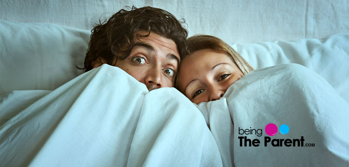 Frightened couple in bed
