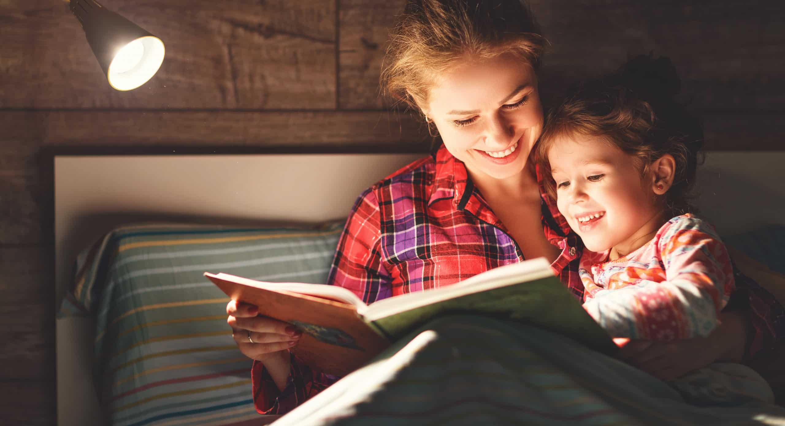 mom and kid reading bed-time story