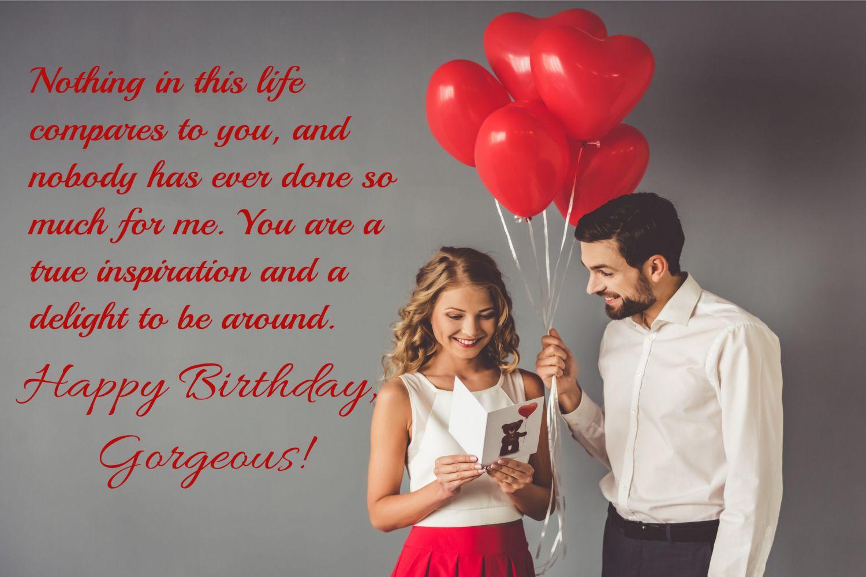 couple with card and ballon