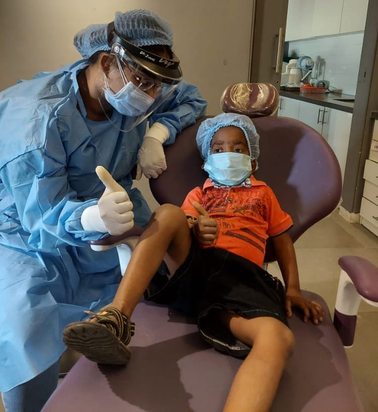 dentist with a happy kid