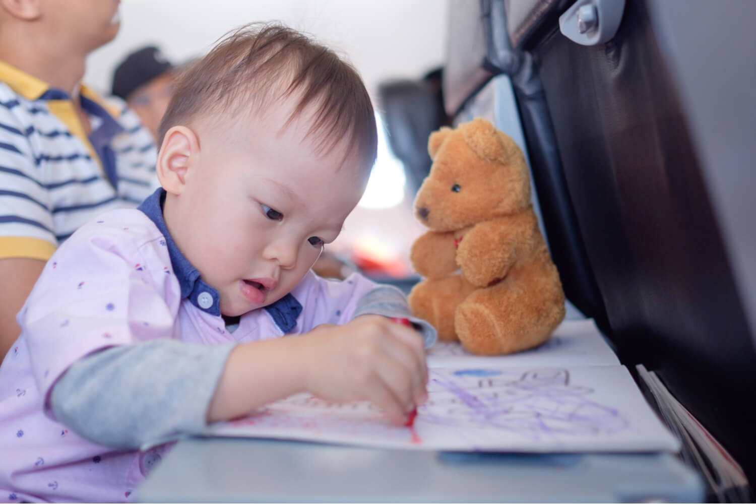 toddler colouring in a flight