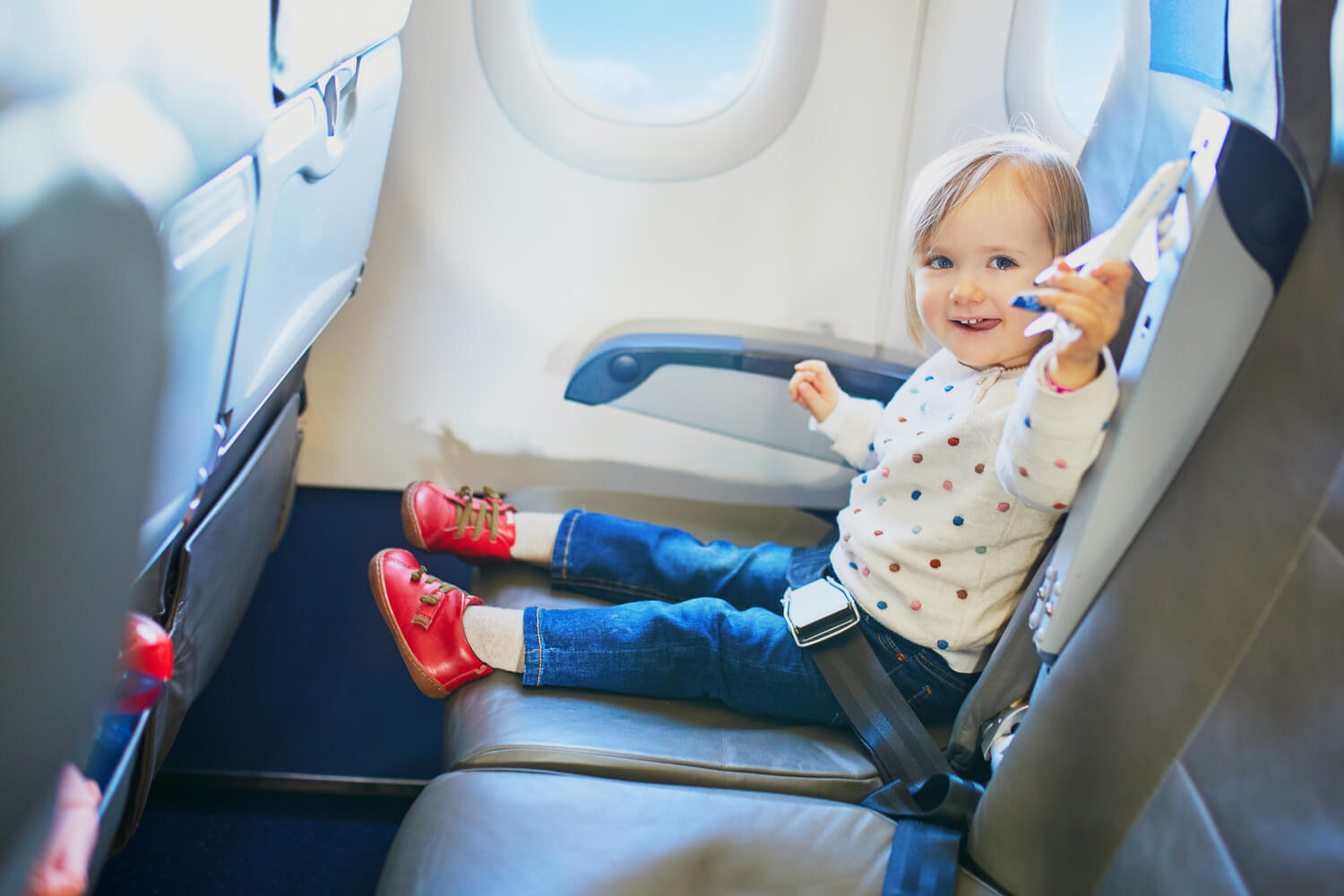 toddler playing in a flight
