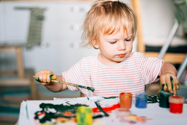 kid doing painting