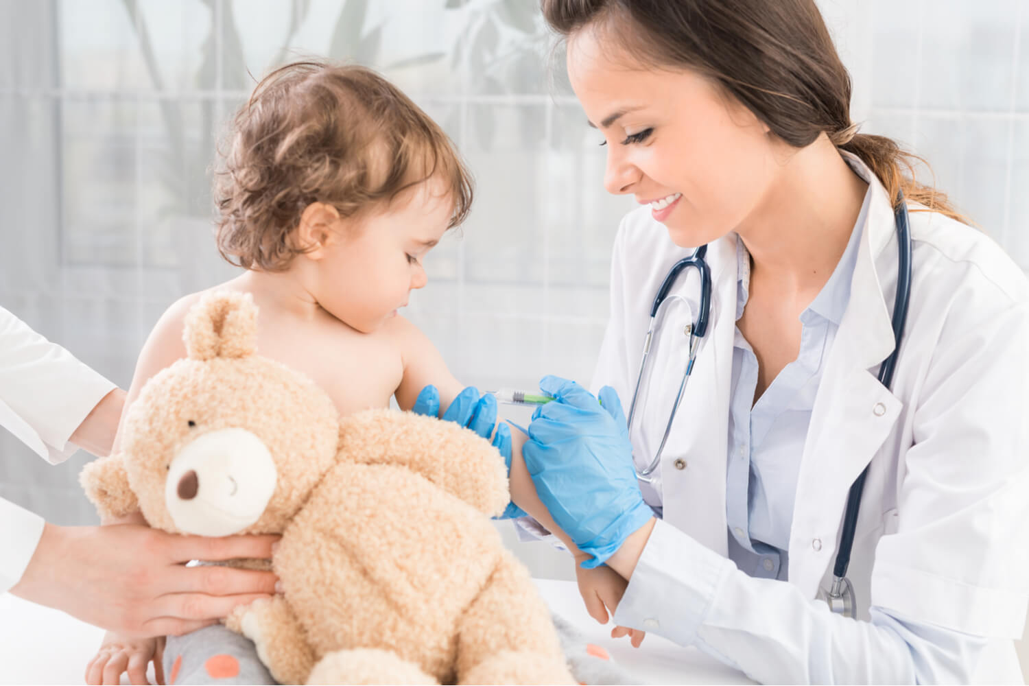 doctor giving MMR vaccine to baby