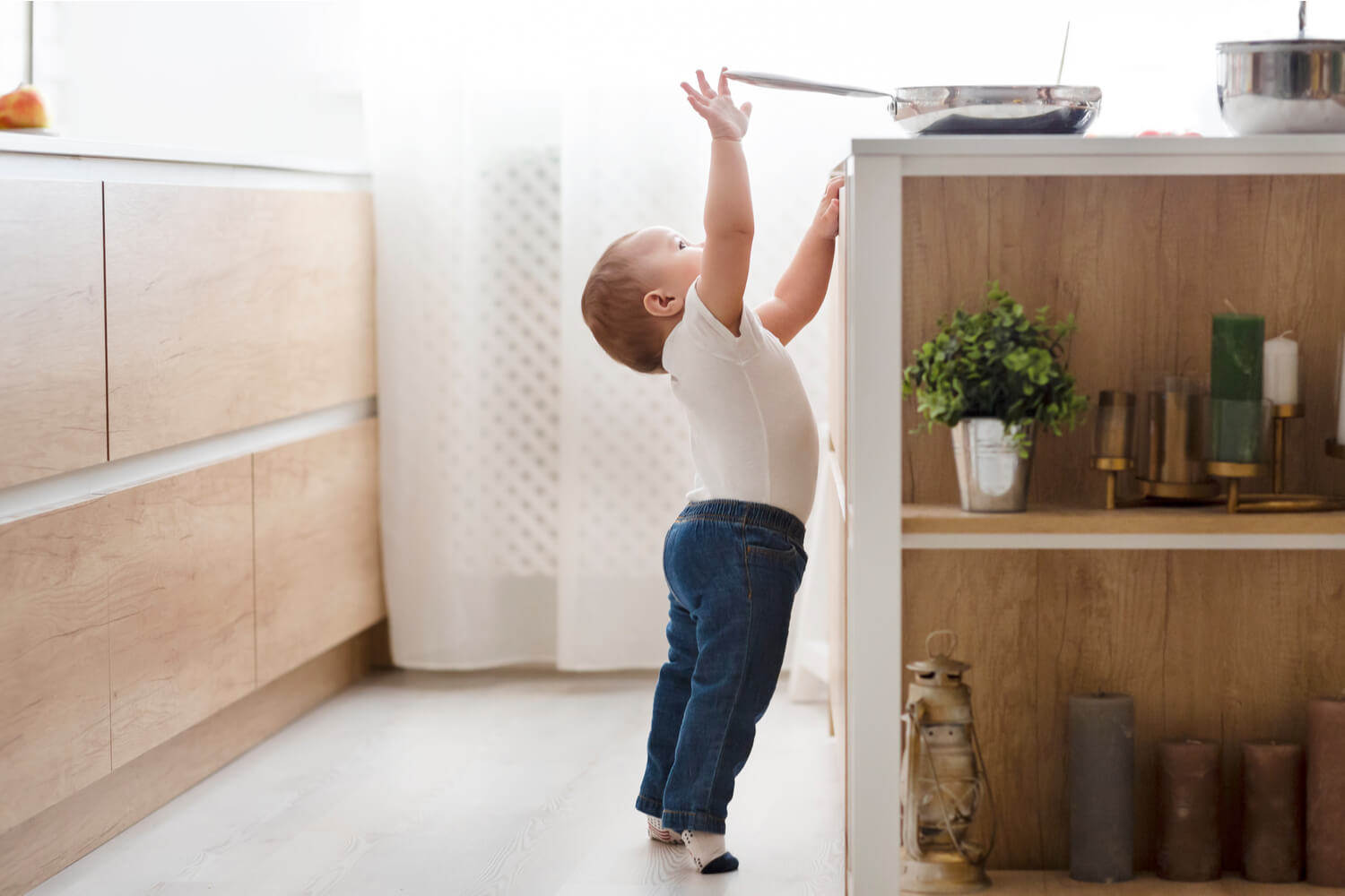 baby trying to reach hot pan