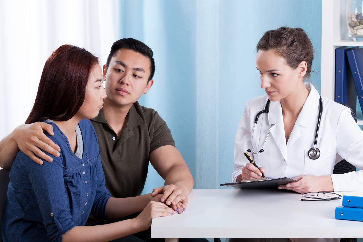 couple consulting doctor after miscarriage