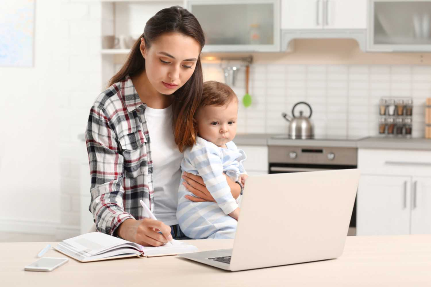 women holding kid and working
