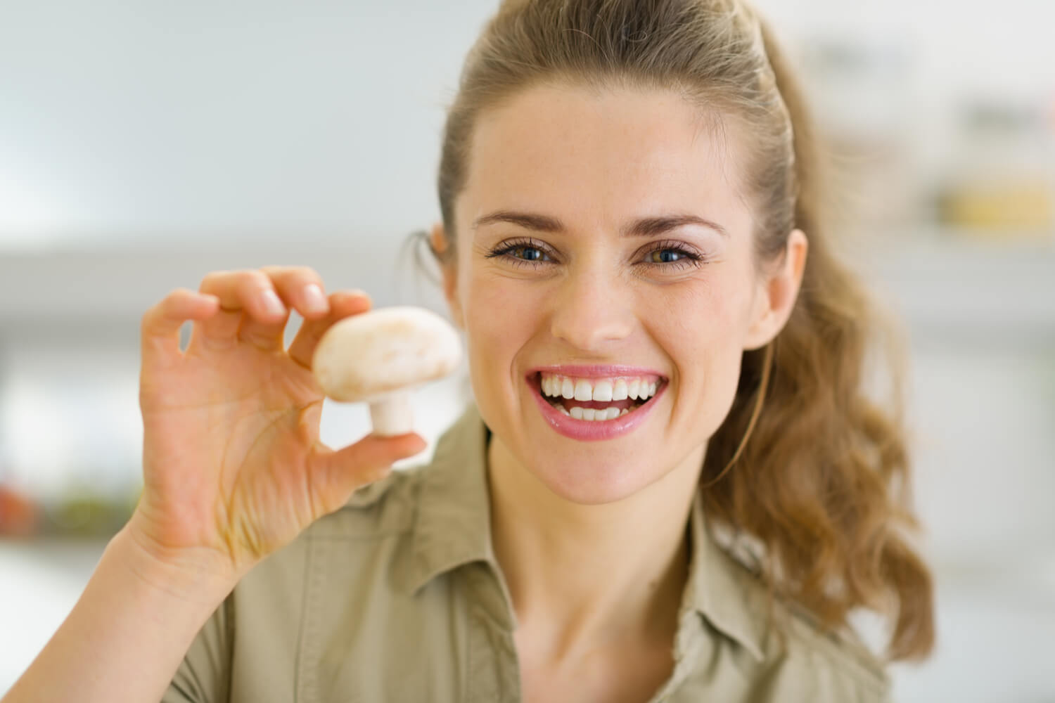 woman with mushroom smiling