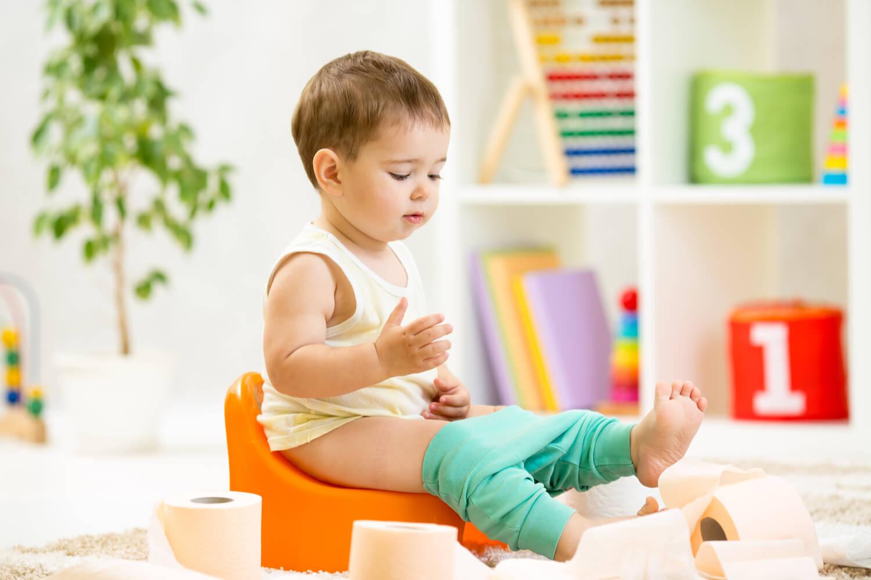baby sitting on chamber pot