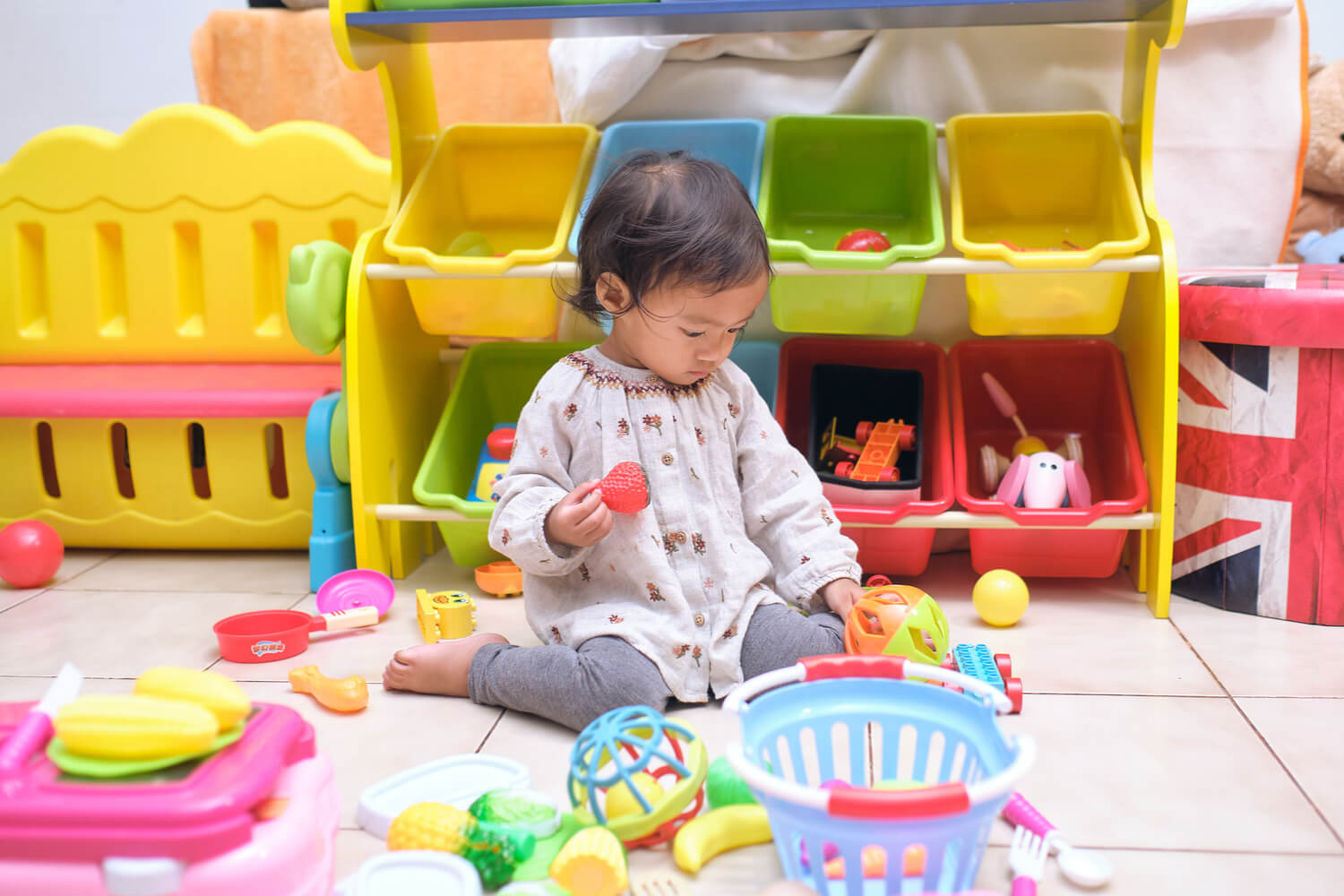 girl sitting W posture and playing